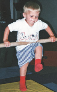 Young Andrew on bars