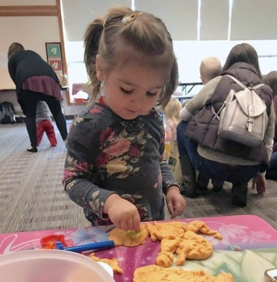 little girl playing at geauga county library event