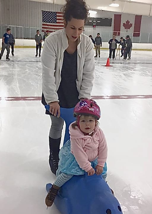 mother and daughter skating at the pond family friendly ice rink in chagrin falls ohio