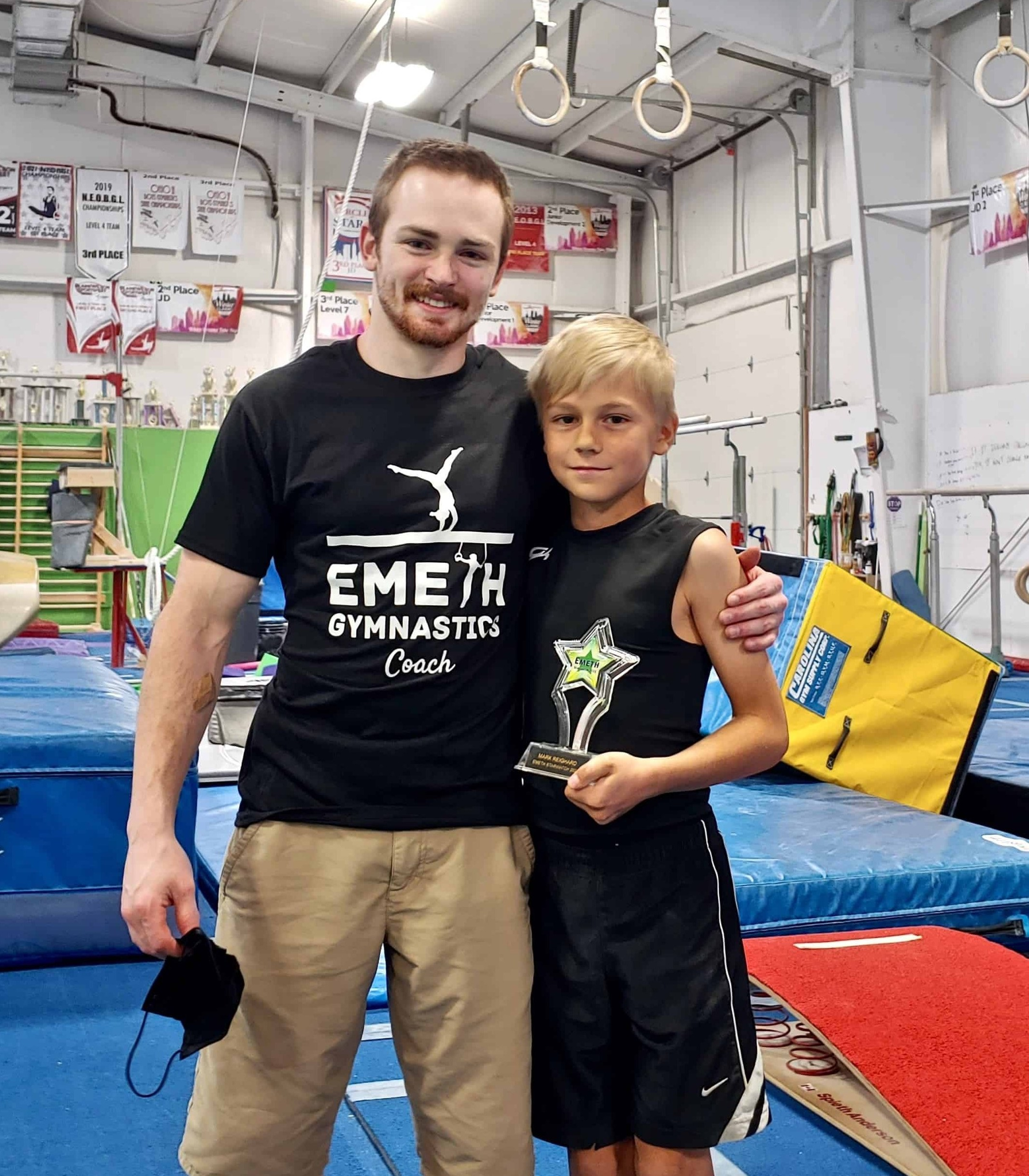 Boys gym coach with student