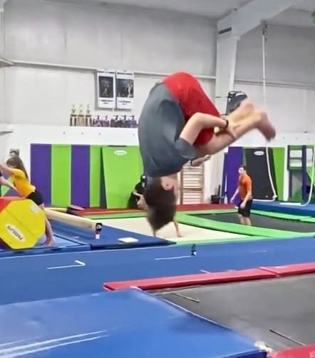boy doing front tuck