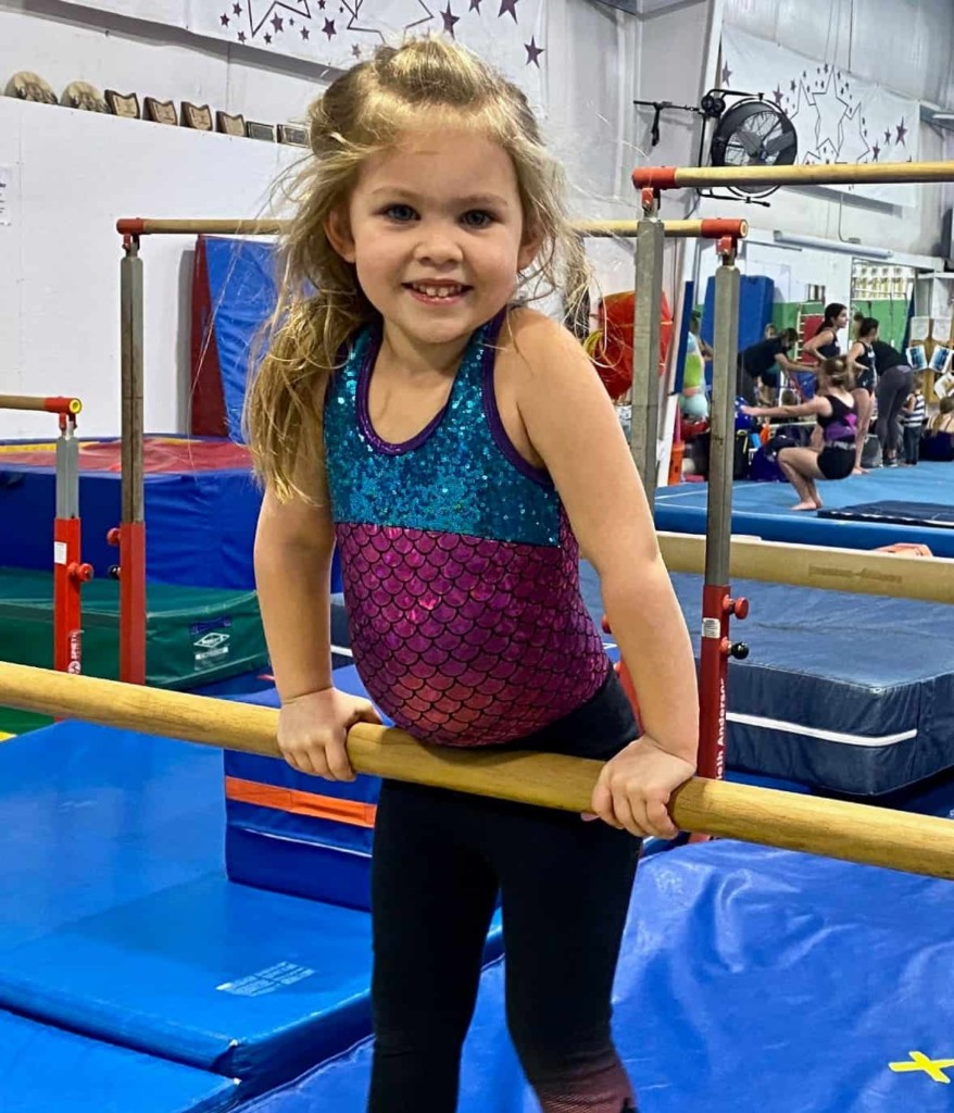 girl in gym on bars