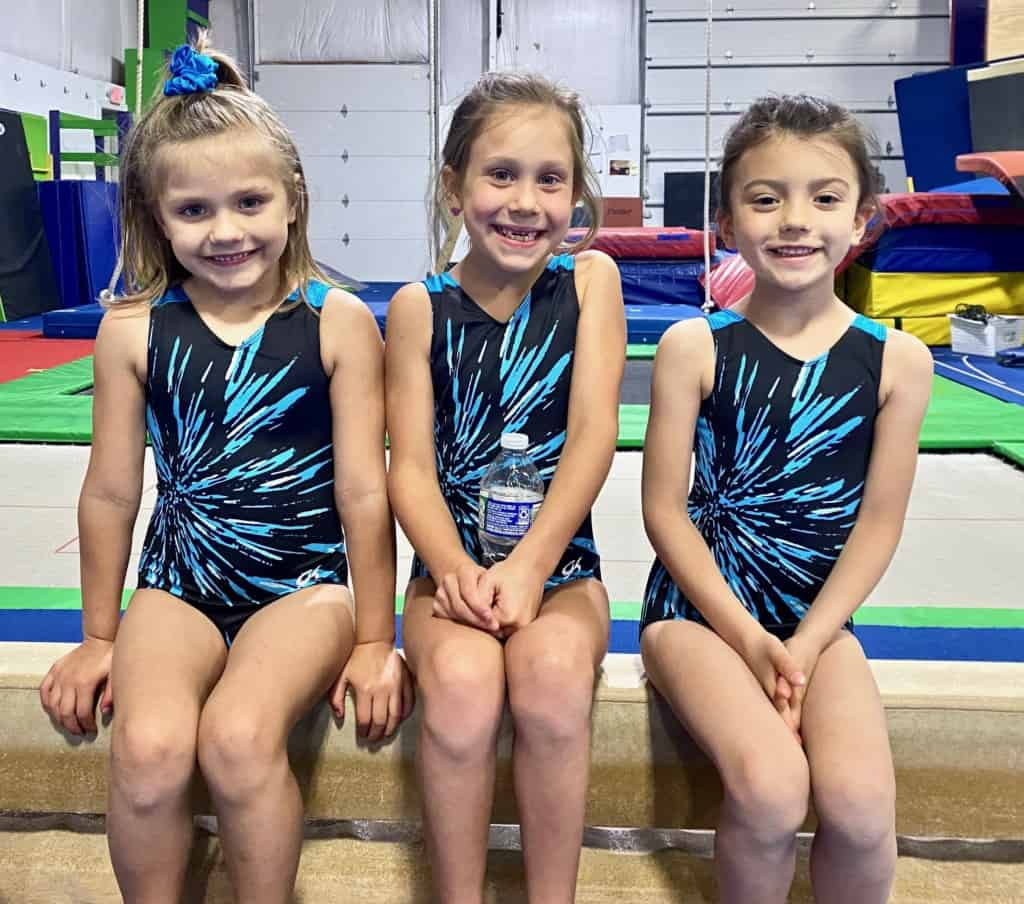 girls in gym on beam