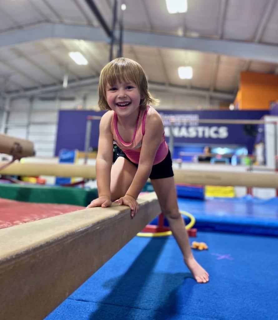 Child on balance beam