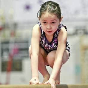 girl on beam